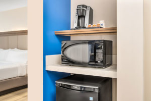 room amenities including a Keurig, microwave, and mini fridge